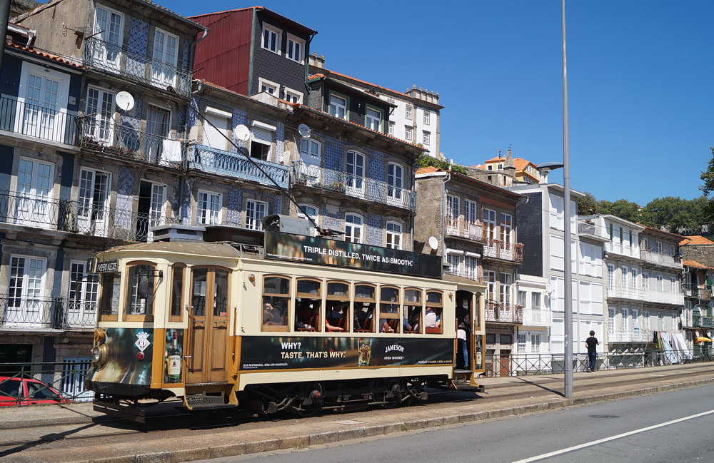The 1.3 million inhabitants can get around using an extended modern light rail network, while the rails of the historic lines zigzagging on the steep downtown streets are polished by the wheels of the plenty vintage trams. But what's this advertisement for an Irish whiskey in English in the city world-famous for its fortified wines?