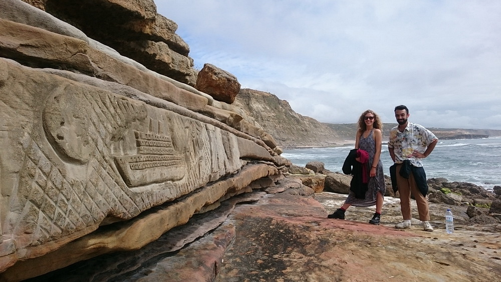 A modern-age rock carving on the left and my local friends in the background.